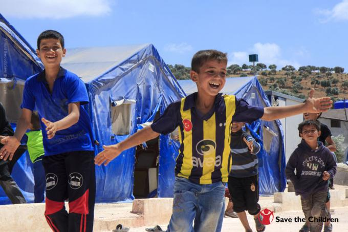 A young boy celebrates after scoring a goal at a football match organised at a Child Friendly Space run by Save the Children in northern Syria.