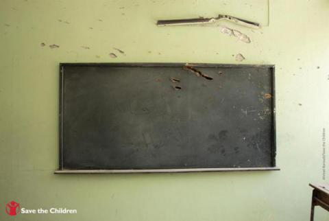 Inside a classroom at a school supported by Save the Children in northern Syria that was severely damaged in an airstrike.